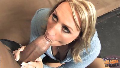 Busty blonde woman is eagerly sucking a fat, black bushwa and getting it from the back