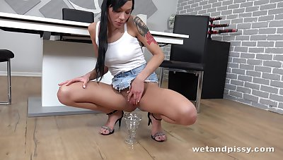 Sexy babe in wet white top Adelle Sabelle is pissing all relinquish make an issue of place