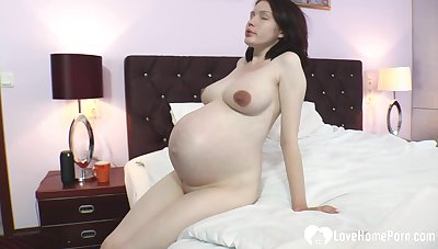 My wife enjoys ribbing with her big belly greatest extent her naked body is exposed