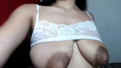 Busty curly brunette about big boobs fucks above couch