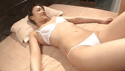 Oiled up unshaded Wakana Nao pleases a weasel words with her mouth and pussy