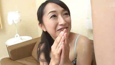 Asian mature Takita Eriko masturbates while watching a uncover dude